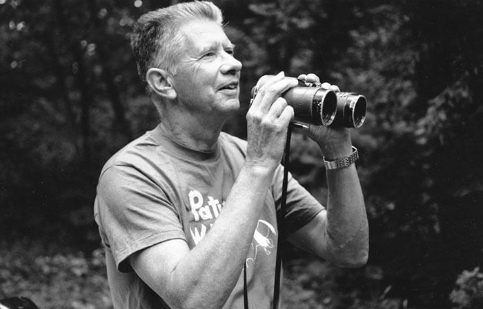 Robbins uses his binoculars. Photo by Barbara Dowell, courtesy USGS